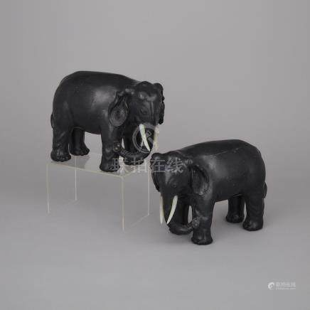 A Pair of Black Jade Elephants, 墨玉雕象擺件一對, height 7.5 in — 19 cm (2 Pieces)