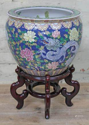 A Chinese porcelain fish bowl, bearing six character Guangxu mark to base, on wooden stand, height