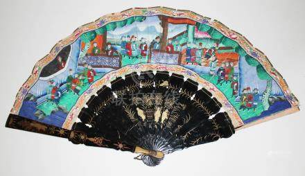 A Chinese black lacquer and painted fan.