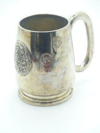 Eastern white metal pint tankard with embossed circular plaque of a deity, marked to base Thailand