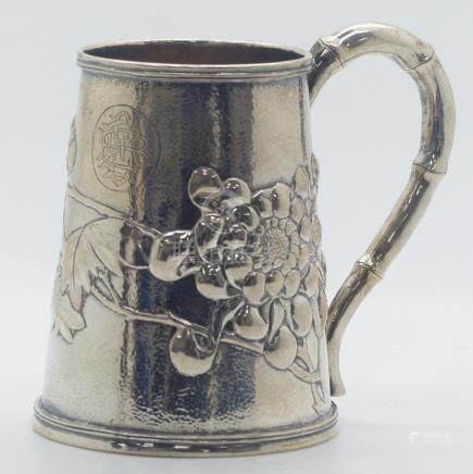 Chinese silver tankard with chrysanthemum and foliate decoration, faux bamboo handle and impressed