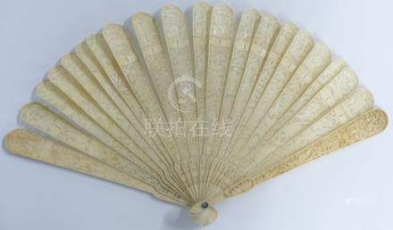A 19thC Chinese ivory fan of 20 sticks, each with carved decoration of figures, village scenes