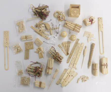 A collection of mostly Chinese 19thC carved ivory pieces, puzzles pieces, fan parts, panels etc