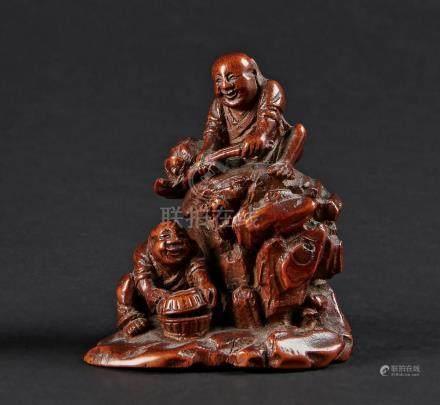 CHINE - XVIIIe/XIXe siècleGroupe en bambou sculpté, les frères Hehe, l'un assis