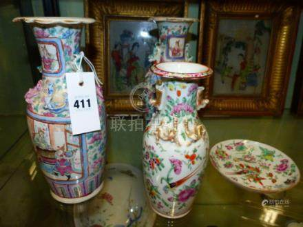 A PAIR OF 19TH.C.CANTON VASES PAINTED WITH COURT AND BATTLE SCENES BELOW BUDDHIST LION HANDLES. H.