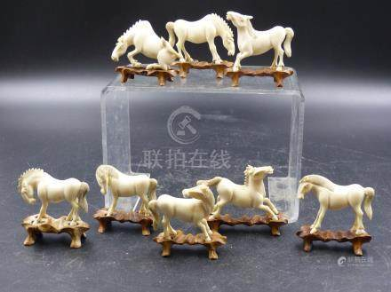THE EIGHT HORSES OF MU WANG, THE CHINESE IVORIES WITH WOODEN STANDS EACH H.5CMS.
