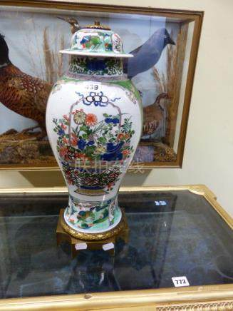 A FAMILLE VERTE BALUSTER VASE AND COVER ORMOLU MOUNTED AS A LAMP. H.53CMS.