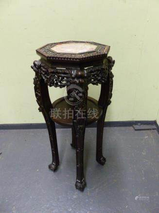 A CHINESE CARVED HARDWOOD OCTAGONAL STAND WITH INSET MARBLE TOP AND CONFORMING CIRCULAR UNDERTIER ON