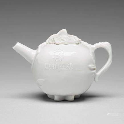 A pomegranate-shaped blanc de chine teapot with cover, Qing dynasty, Kangxi (1662-1722).