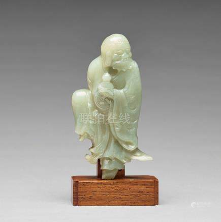 A finely carved nephrite sculpture of an immortal, Qing dynasty, probably Qianlong (1736-95).