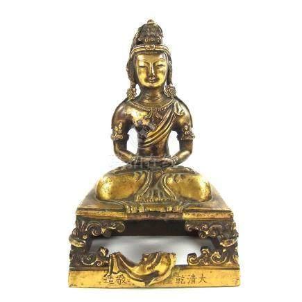 A Chinese gilt bronze figure of Amitayus Buddha, 18th century.