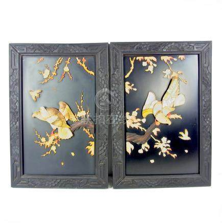 A pair of Chinese lacquered decorative panels.