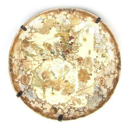 A large Japanese Satsuma charger, Meiji period (1868 - 1912). 16.3 in (41.5 cm) diameter.
