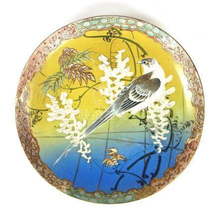 A Japanese porcelain charger, early 20th century.