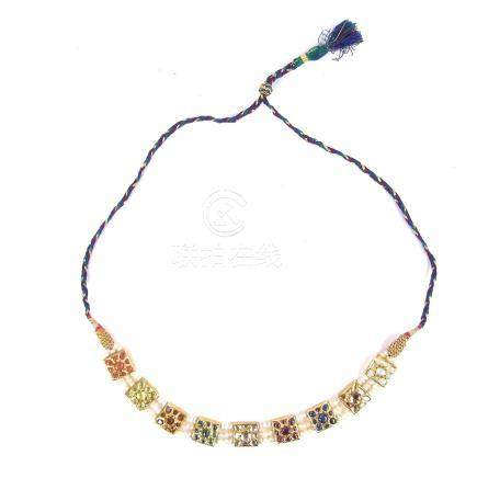 A Mughal style yellow gold multi-gem Navaratna Indian necklace.
