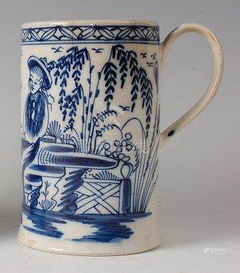 An 18th century English pearlware tankard, underglaze blue decorated with a figure and pagoda