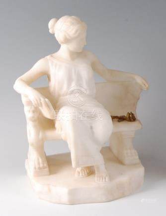 A 19th century Italian carved marble figure of a maiden , in seated pose with book in hand, signed