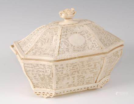 A 19th century Chinese Canton carved ivory basket and cover, of sarcophagus form, with swing carry