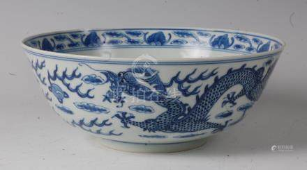 A Chinese export blue and white dragon bowl, the interior and exterior decorated with four-claw