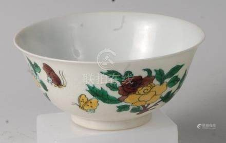 A Chinese wucai style porcelain bowl, having incised dragon decoration overpainted with insects
