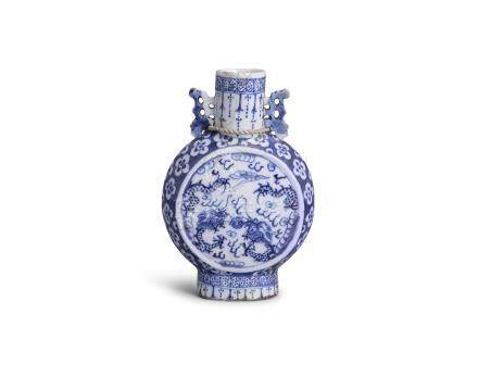 A CHINESE SMALL BLUE AND WHITE MOONFLASK, 19th century, painted on each side with dragons in flight,