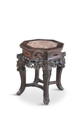 A CHINESE HARDWOOD AND MARBLE INSET OCTAGONAL JARDINERE STAND, with beaded border and leaf carved
