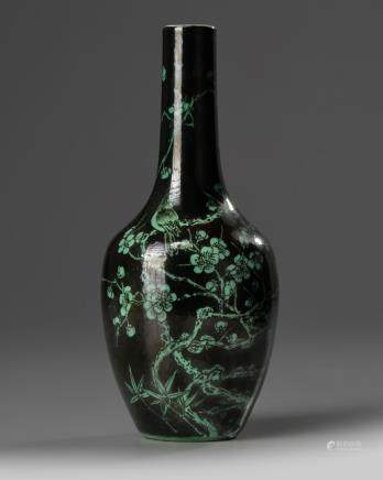 A small Chinese famille noir 'bird' vase