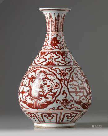 A Chinese iron-red-decorated pear-shaped vase, yuhuchunping