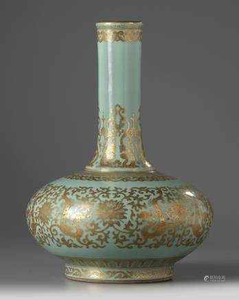 A Chinese celadon-ground gilt-decorated bottle vase