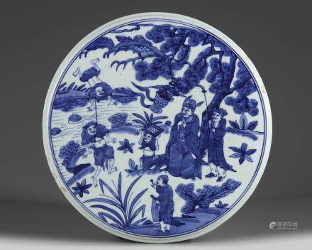 A Chinese blue and white circular plaque