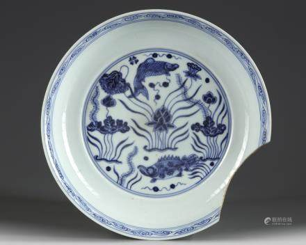 A Chinese flambe and blue and white 'fish' dish