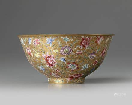 A Chinese gilt-ground famille rose bowl