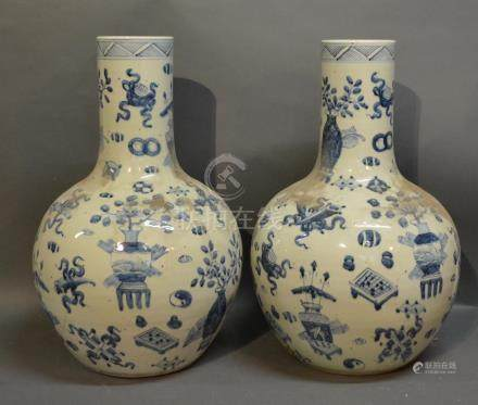 A Pair Of Chinese Porcelain Large Bottle Neck Vases, decorated in under glaze blue, 59cm tall