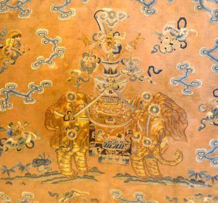 An 18th Century Chinese Silk And Gold Thread Embroidery depicting an elephant carrying a vase