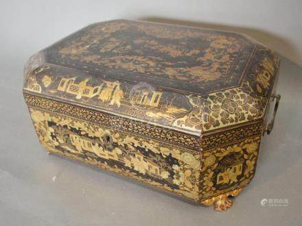 An Early 19th Century Chinese Export Lacquered Tea Caddy of octagonal form, the hinged cover
