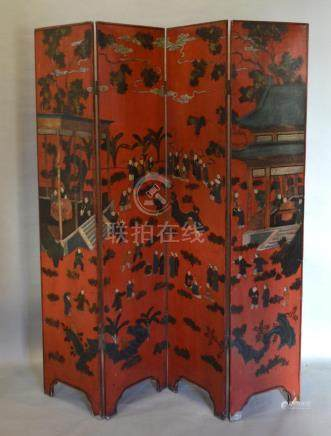 A Chinese Lacquered Four Fold Screen Decorated With Figures and buildings amongst foliage upon a red