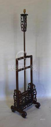 A Chinese Hardwood Adjustable Lamp Standard of pierced scroll form, 147cm high