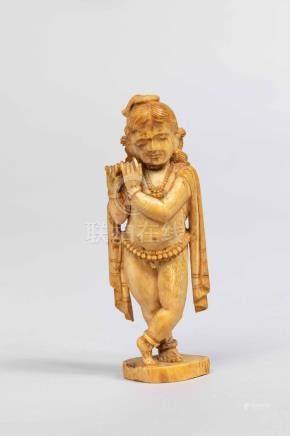 Venukopalakrishna figurée enfant nu paré de joyaux et d'une écharpe jouant de l