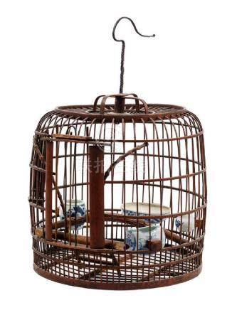 * A Chinese Bamboo Birdcage Height 18 inches.