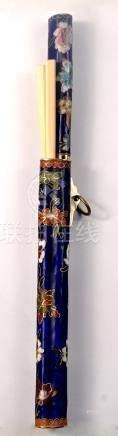 A vintage enamelled knife and chopstick set - decorated with lotus flowers etc