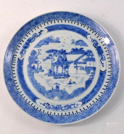 Blue and white pagoda scene plate 25cm wide