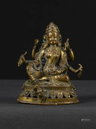 A Very Nice Gilt Bronze Figure of seated 6 Armed