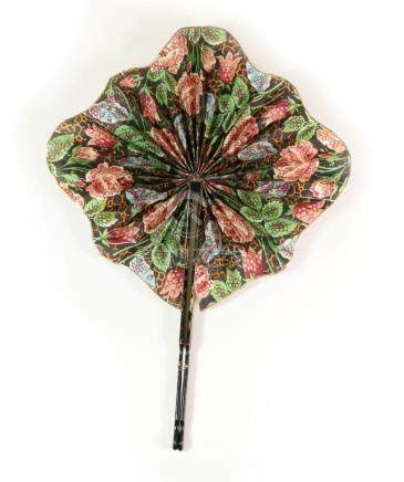 A Late 19th Century Chinese Cockade Fan, the colourful paper leaf mounted on black and gold