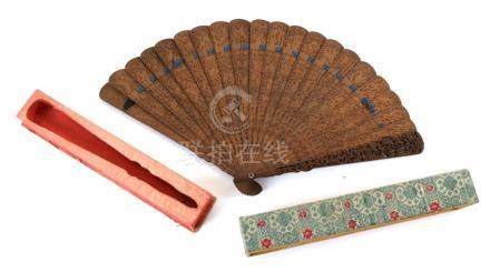A Chinese Late 19th Century Dark-Stained Carved Wood Brisé Fan, Qing Dynasty, contained in the