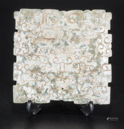A Chinese Q'ing dynasty snow flake jade carved plaque