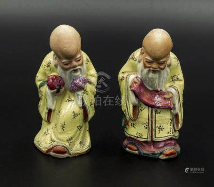 Two small Chinese pottery figures of sages