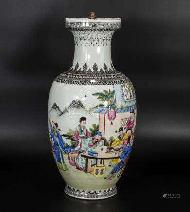 A Chinese Republic vase decorated in Famile enamels depicting scholars, 37cm tall