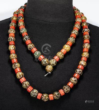 A Tibetan engraved agates and red stone string of beads