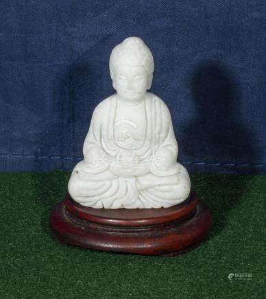 A small jade Buddha and stand