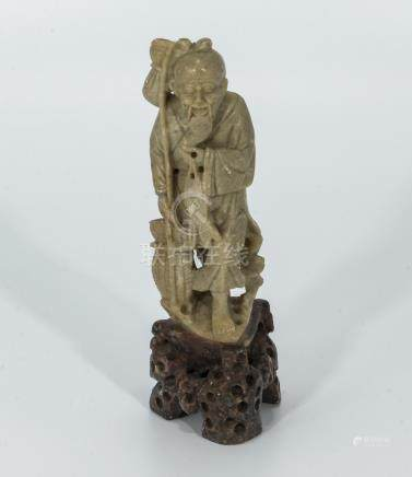Q'ing dynasty hardstone carving of a fisherman and catch